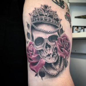 skull with crown tattoo meaning, skull with halo tattoo meaning, skull and crown tattoo meaning