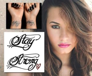 demi lovato signature heart, demi lovato stay strong tattoo, demi lovato stay strong tattoo font