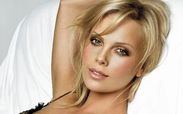 Charlize Theron's Tattoos