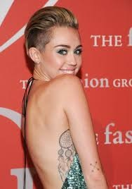 Miley Cyrus crossed arrow feather tattoo