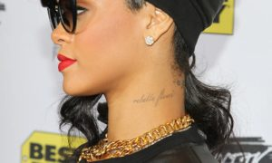 rebel flower rihanna, rhiannas neck tattoo, rhiannas new tatoo, rhiannas new tattoo