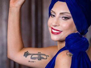 gaga trumpet tattoo, laddy gagas tattoos, lady gaga arm tattoo meaning