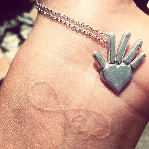 Shay Mitchell Tattoos